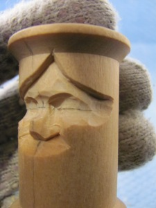 Use the 10mm #11 to narrow the face at the eye line and a knife to smooth the ridges at the temple.