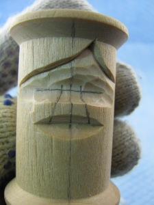 Cut below the nose at the line. Just use a knife. Make sure the cut deep enough to expose the width of the nose.